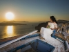 bride in santorini sunset